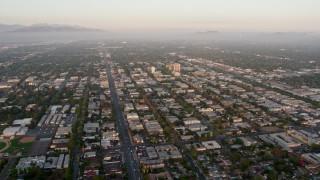 AX44_001 - 4K stock footage aerial video flying by urban neighborhoods in Van Nuys, California, sunset