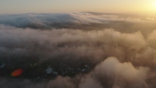 AX44_008 - 4K stock footage aerial video of the marine layer over hills, Studio City, California, sunset