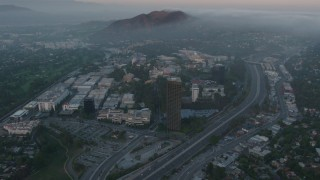 AX44_018 - 4K stock footage aerial video of fog rolling in near Universal City, Universal Studios, California, sunset