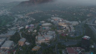 AX44_019 - 4K stock footage aerial video approaching Universal Studios, Hollywood, California