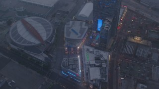 AX44_046 - 4K stock footage aerial video of a wide shot of Staples Center and Nokia Theater, Downtown Los Angeles, twilight