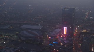 AX44_060 - 4K stock footage aerial video approaching Staples Center panning to The Ritz-Carlton, Los Angeles, night
