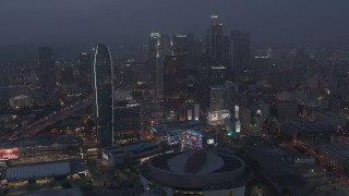 AX44_063 - 4K stock footage aerial video approaching skyscrapers and high-rises, Downtown Los Angeles, night