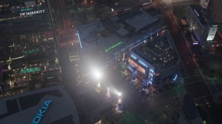 AX44_064 - 4K stock footage aerial video of a bird's eye of LA Live, Downtown Los Angeles, night
