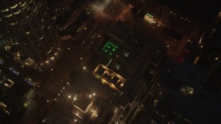 AX44_080 - 4K stock footage aerial video orbiting Los Angeles Public Library and tilt down, Downtown, night