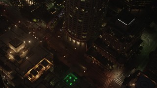 AX44_081 - 4K stock footage aerial video of city streets and buildings, Downtown Los Angeles, night