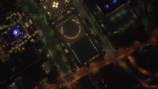 AX44_082 - 4K stock footage aerial video of a bird's eye of city streets and buildings, Downtown Los Angeles, night