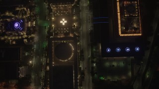 AX44_083 - 4K stock footage aerial video of a bird's eye over city streets and buildings, Downtown Los Angeles, night