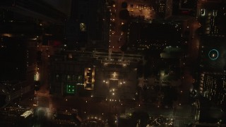 AX44_084 - 4K stock footage aerial video of a bird's eye of city streets and buildings, Downtown Los Angeles, night