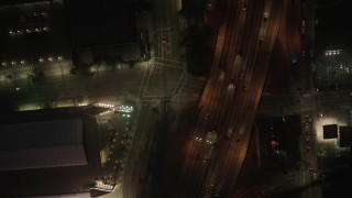AX44_086 - 4K stock footage aerial video of bird's eye of city streets and skyscrapers, Downtown Los Angeles, night