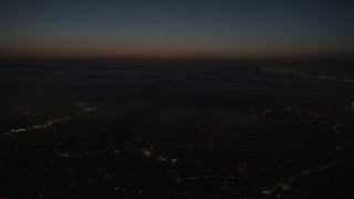 AX44_091 - 4K stock footage aerial video of the marine layer over the city, Los Angeles, California, night