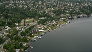 AX45_001 - 5K stock footage aerial video flying by lakefront homes, Rainier Beach, Washington