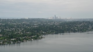 AX45_002 - 5K stock footage aerial video of skyline seen from lakefront homes, Rainier Beach, Seattle, Washington