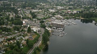 AX45_003 - 5K stock footage aerial video approaching a small lakeshore marina and waterfront condo complexes, Rainier Beach, Washington