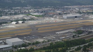 AX45_008 - 5K stock footage aerial video of parked commercial jets at Boeing Field, Washington
