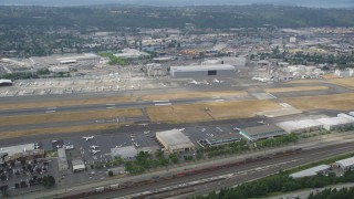 AX45_010 - 5K stock footage aerial video of parked commercial jets at Boeing Field, Seattle, Washington