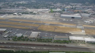 AX45_011 - 5K stock footage aerial video flying by parked airliners at Boeing Field, Seattle, Washington