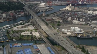 AX45_015 - 5K stock footage aerial video approaching and tilt down to the West Seattle Bridge, Harbor Island, Washington