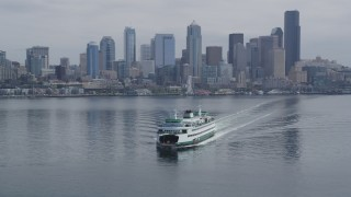 AX45_021 - 5K stock footage aerial video tracking a ferry sailing away from Downtown Seattle skyline, Washington