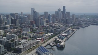 AX45_030 - 5K stock footage aerial video of Downtown Seattle skyline seen from Elliott Bay, Seattle, Washington