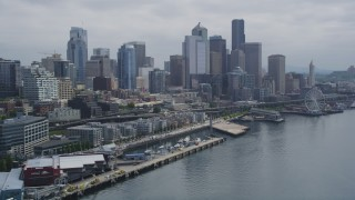 AX45_032 - 5K stock footage aerial video of Downtown Seattle skyline and Central Waterfront seen from Elliott Bay, Washington