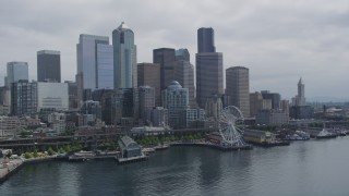 AX45_033 - 5K stock footage aerial video flying by skyline and the Seattle Great Wheel on Pier 57, Downtown Seattle, Washington