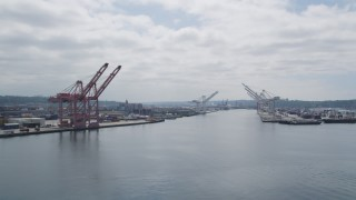 AX45_036 - 5K stock footage aerial video flying by cargo cranes on Harbor Island, Seattle, Washington