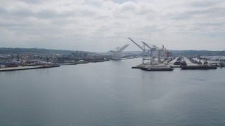 AX45_037 - 5K stock footage aerial video flying by cargo cranes on Harbor Island, Seattle, Washington