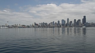 AX45_039 - 5K stock footage aerial video tilting up from Elliott Bay to reveal Downtown Seattle skyline, Washington