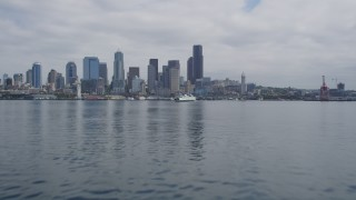 AX45_040 - 5K stock footage aerial video tilting from Elliott Bay to reveal Downtown Seattle skyline and ferry, Seattle, Washington