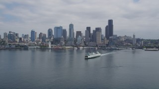 AX45_041 - 5K stock footage aerial video approaching a ferry sailing Elliott Bay near Downtown Seattle, Washington