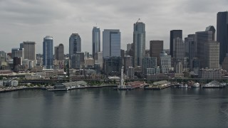 AX45_048 - 5K stock footage aerial video approaching the Seattle Aquarium, Great Wheel and Downtown Seattle skyline, Washington