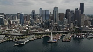 AX45_049 - 5K stock footage aerial video approaching the skyline and Waterfront, and tilt down to the Great Wheel, Downtown Seattle, Washington