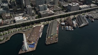 AX45_050 - 5K stock footage aerial video tilting to bird's eye view of the Great Wheel, Pier 56, and Alaskan Way Viaduct in Downtown Seattle, Washington