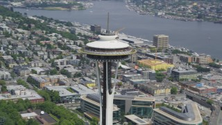 AX45_054 - 5K stock footage aerial video orbiting the top of the famous Space Needle in Seattle, Washington