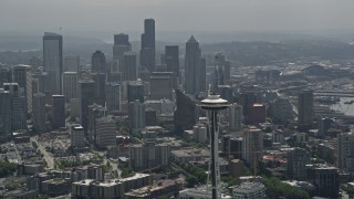 AX45_055 - 5K stock footage aerial video orbiting top of the Space Needle to reveal the Downtown Seattle skyline, Washington