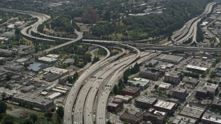 AX45_060 - 5K stock footage aerial video following I-5 Express to approach interchange with I-90 Express, Greater Duwamish, Seattle, Washington