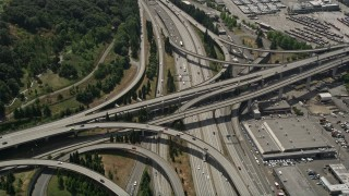 AX45_061 - 5K stock footage aerial video flying by and tilting to light traffic on the I-5 and I-90 Express interchange, Greater Duwamish, Seattle, Washington