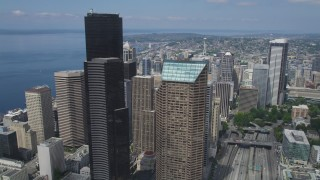 AX45_065 - 5K stock footage aerial video following I-5 by Columbia Center and approach Space Needle in the distance, Downtown Seattle, Washington