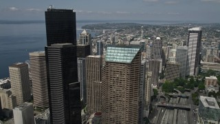 AX45_066 - 5K stock footage aerial video flying over downtown buildings to approach the Space Needle, Downtown Seattle, Washington
