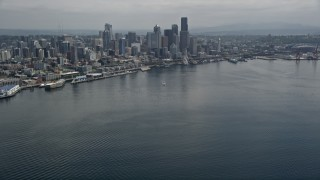 AX45_071 - 5K stock footage aerial video tilting from Elliott Bay to reveal the skyline of Downtown Seattle, Washington