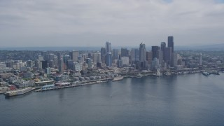 AX45_072 - 5K stock footage aerial video approaching the Waterfront and Downtown Seattle skyline from Elliott Bay, Washington