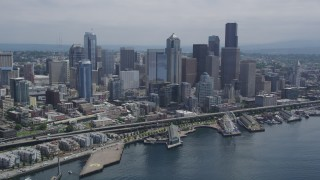 AX45_073 - 5K stock footage aerial video flying over Elliott Bay toward the Seattle Waterfront and the Downtown Seattle skyline, Washington