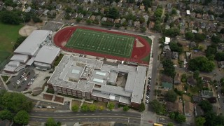 AX45_079 - 5K stock footage aerial video of a bird's eye view of Garfield High School and football field, Central Seattle, Washington