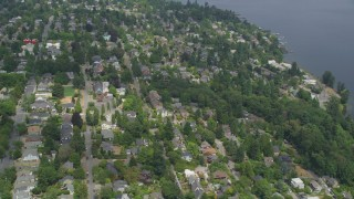 AX45_081 - 5K stock footage aerial video flying over a tree-lined residential neighborhood, Madrona, Seattle, Washington