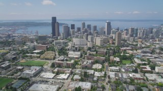 AX45_085 - 5K stock footage aerial video flying over Seattle University campus to approach Downtown Seattle, Washington