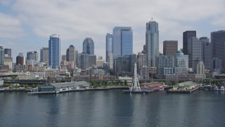 AX45_097 - 5K stock footage aerial video flying by Downtown Seattle skyline, Seattle Aquarium and Great Wheel, Downtown Seattle, Washington