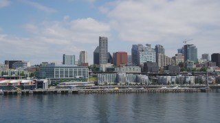 AX45_098 - 5K stock footage aerial video flying by Waterfront piers and high-rises to reveal the Space Needle, Downtown Seattle, Washington