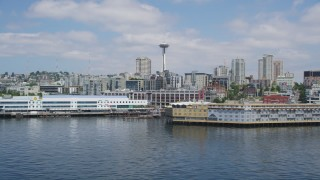 AX45_099 - 5K stock footage aerial video flying by Waterfront piers with Space Needle in background, Downtown Seattle, Washington