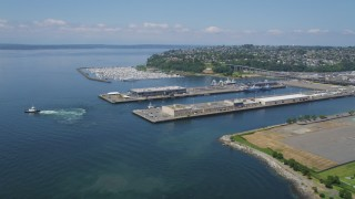 AX45_102 - 5K stock footage aerial video approach warehouse buildings on Pier 90 and 91 near the marina, Smith Cove, Seattle, Washington